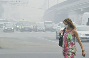 Moscow smog: A Russian woman wears a face mask while walking in central Moscow