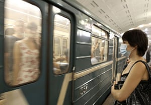 Moscow smog: A woman wears a mask as she waits for a train at an underground station