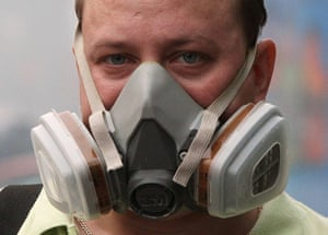 Moscow smog: A man wears a mask to protect himself from the smog in central Moscow