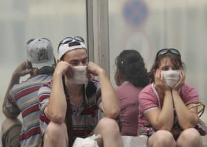 Moscow smog: People sit and wait for their flights at Vnukovo airport outside Moscow