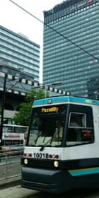 A Metrolink tram and the City tower in Manchester city centre. Photograph: Paul Owen.