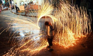 Ramadan: A Palestinian boy plays with fireworks to celebrate the holy month Ramadan