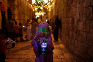 Ramadan: A young Palestinian Muslim girl walks in  an alley of Jerusalem's old city