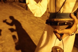Ramadan: A Musaharati (dawn awakener) strikes his drum in Sidon's Old City