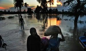 Pakistani flood survivors walk in the fl