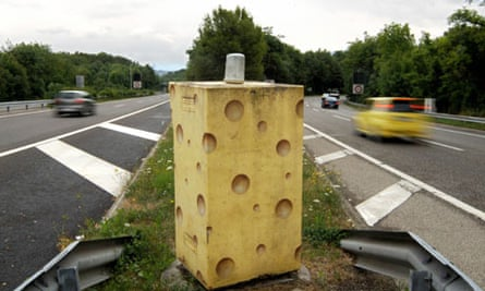 A speed camera painted as Emmenthal cheese on a motorway in Switzerland