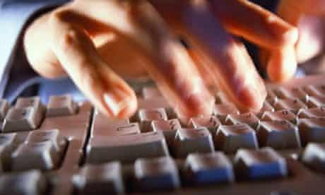 Man at a computer keyboard