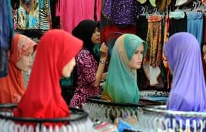Ramadan update: A vendor decorates her stall in Kuala Lumpur