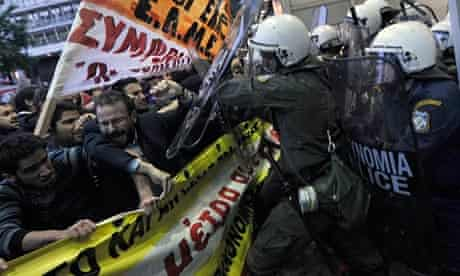 Protesters clash with riot policemen in Athens