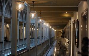 Taj Mahal Palace hotel: Hotel staff walk through the newly-restored heritage wing