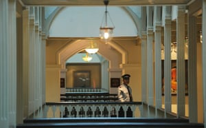 Taj Mahal Palace hotel: A security guard walks through the newly-restored heritage wing
