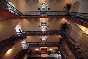 Taj Mahal Palace hotel: A man walks through a renovated passageway of the heritage wing