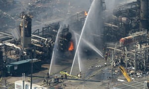 Firefighters extinguish the last flames after the explosion at the Texas City oil refinery in 2005