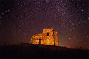 Perseid meteors: A meteor streaking across the night sky over Bukelon castle