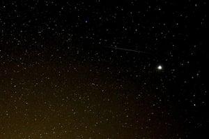 Perseid meteors: A meteor streaks across the sky against a field of stars