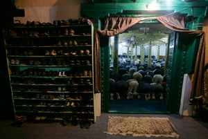 Ramadan Update: Muslims attend an evening prayer session at a mosque in Kashmir