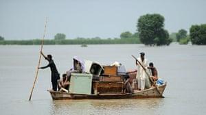Pakistan Flood Disaster: Pakistani flood survivors use a boat to
