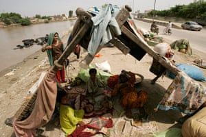 Pakistan Flood Disaster: A displaced Pakistani flood affected family in their makeshift home