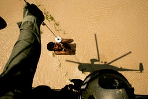 Pakistan Flood Disaster: A villager is rescued by a Pakistani navy helicopter, flood distaster