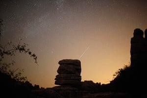 perseid meteor update: A meteor streaks past stars over El Torcal nature park Spain
