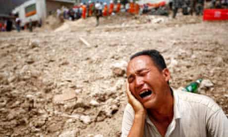 Man grieves in landslide-hit Gannan Tibetan Autonomous Prefecture, China