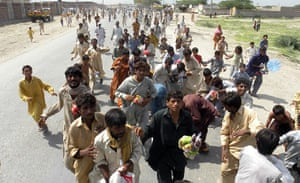 Pakistan flood survivors: Flood victims struggle to get relief goods distributed by the Army