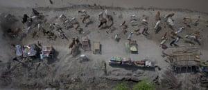 Pakistan flood survivors: Flood victims taking refuge on a levy wait for relief supplies