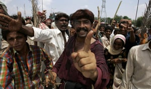 Pakistan flood survivors: Angry flood survivors gesture as they block a highway