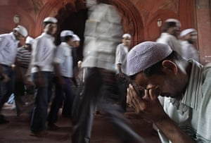 Pakistan flood survivors: A devout Muslim man wipes away tears after a prayers session in New Delhi