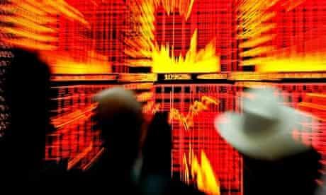 Chinese investors monitor trading screens