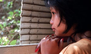 A 16-year-old Cambodian girl hides after being rescued from a brothel were she was forced to work.