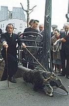 Salvador Dali with his pet anteater