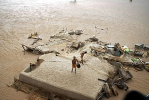 pakistan flooding: Villagers stand on a rooftop