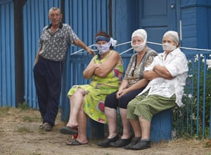 Forest fires in Russia: Local residents cover their noses from the smog in the village of Vilya