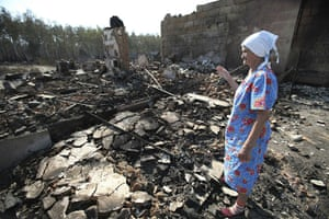 Forest fires in Russia: A Russian woman looks at the remains of her burnt out home in Voronezh