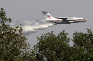 Forest fires in Russia: A Russia Iliushin-76 tanker plane releases water on a forest fire