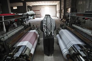 Keffiyeh factory Hebron: All but one of the looms was idle, its clacking echoing around the factory