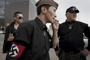 Mongolian neo-Nazis: The group's co-founder, right, with members on the streets of Ulan Bator