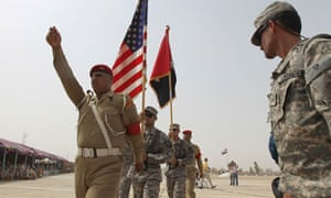 U.S. soldiers during a departure ceremony of U.S. Forces, at Abu Ghraib in Baghdad