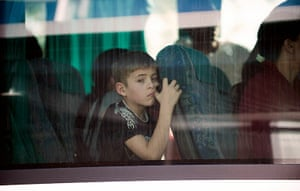 Roma deportation: A young boy arrives by bus at Charles de Gaulle airport