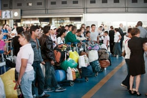 Roma deportation: Roma community queue for boarding procedures at Charles de Gaulle airport