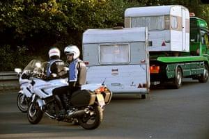Roma deportation: A breakdown lorry carries caravans of people belonging to Roma community
