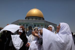 ramadan update: A Palestinian woman splashes cold water on other female worshippers