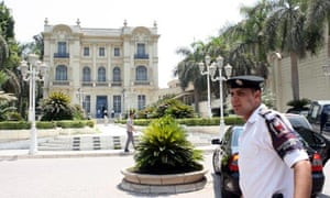 An Egyptian policeman stands near the building of the Mahmud Khalil Modern Art Museum in cairo