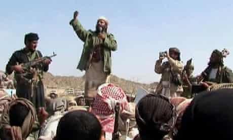 Armed men claiming to be al-Qaida members address a crowd in Yemen's Abyan province