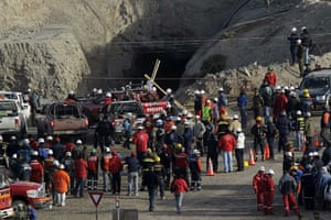 Chilean Trapped Miners: Co-workers, rescuers and relatives gather outside the mine in Copiapo