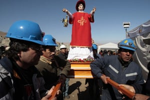 Chilean Trapped Miners: Miners carry an effigy of Saint Lorenzo, patron saint of miners before mass