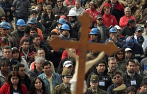 Chilean Trapped Miners: Relatives and miners attend a mass outside the mine