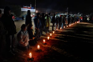 Chilean Trapped Miners: Relatives of trapped miners pray and light candles