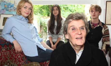 Jane Miller at home with her grandchildren Dora (left), Natasha and Joe